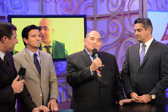 Peter (left) and Gevik Baghdassarian flank their late father Hacop during a past Armenia Fund Telethon