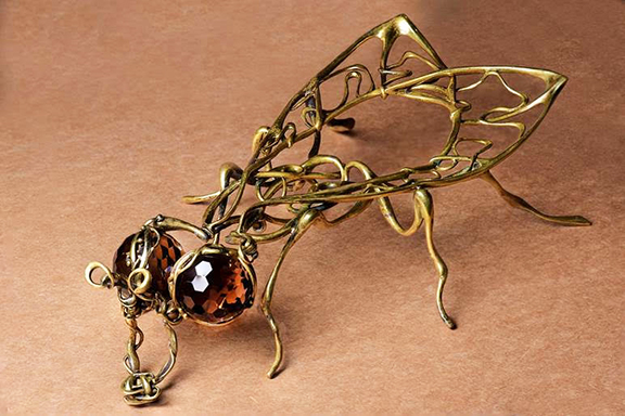 "Nur's ""The Fly,"" made of bronze and topaz"
