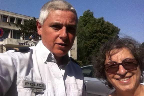 Catherine Yesayan with a French policeman