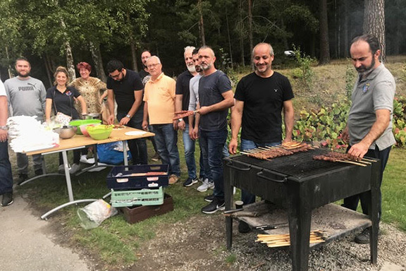 Volunteers making Kebab at the picnic organized by organized by the Armenian Scouts of Södertälje