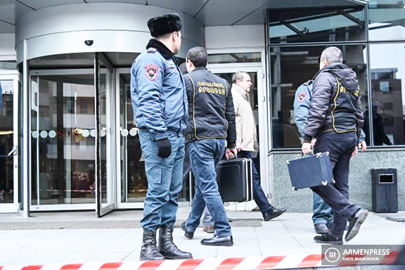 Armenia's national police officers respond to a shooting at Erebuni Plaza in Yerevan on Jan. 23