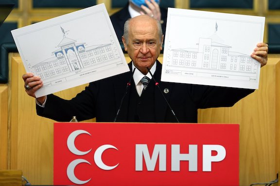 Nationalist Movement Party (MHP) Chairperson Devlet Bahçeli during his party's parliamentary group meeting in Ankara shows the plans of the school to be built in Shushi, Jan. 26, 2021. (Anadolu Agence Photo)