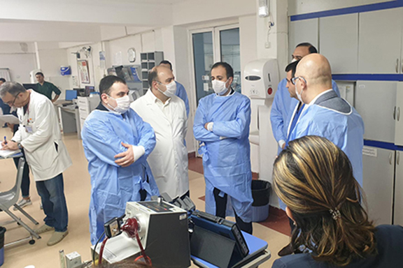 Armenia's Health Minister Arsen Torosyan (center) confers with healthcare professionals