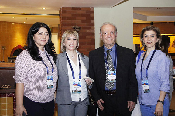From left to right: Zara Hovhannisyan (ABMDR Lab) with conference participants from Iran Mariett Toumians (ABMDR's recruitment officer in Tehran), Dr. Naimi Morteza, and Janet Toumians