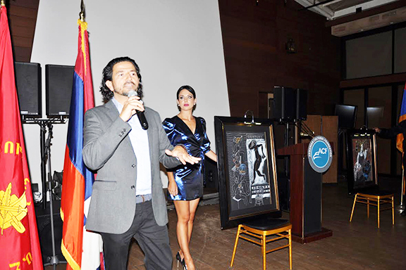 Longtime ACF supporter Peter Baghdassarian leads a live auction with Mistress of Ceremonies Svetlana Bosnoyan