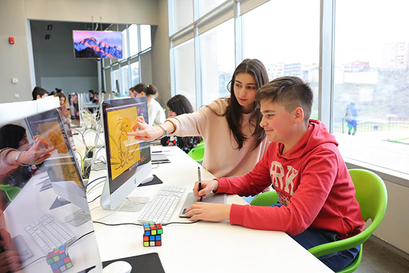 TUMO center attendees are trained in various fields, including web design and 3D modeling