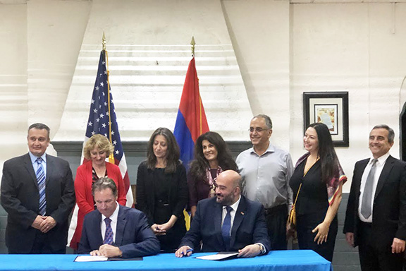 """Founder of the Artsakh YMCA, Davit Melkumyan, joined representatives of the YMCA of Glendale for a ceremonial """"Sister YMCA"""" relationship signing event"""