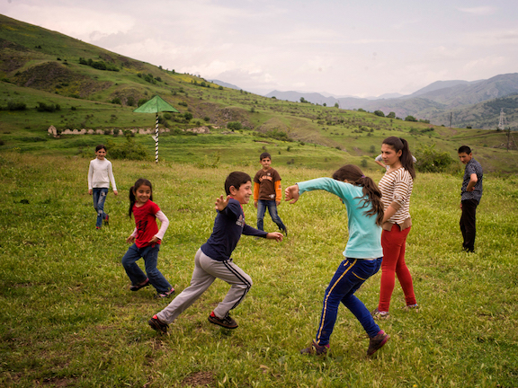 Children from Maratuk village play in front of their school in Tsaghkaberd village. The road between the two villages was heavily mined until it was cleared by The HALO Trust. Photo Credit: The HALO Trust