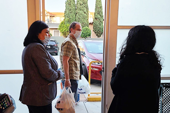 Rep. Adam Schiff takes bags to be delivered to community members