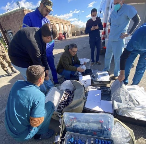 Adventist Health Glendale medical team distributing surgical equipment and supplies in the affected region.
