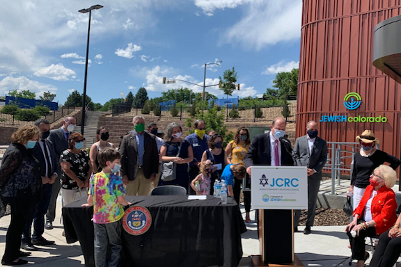 Colorado Governor Jared Polis signs the Genocide Education Bill at a ceremony on July 8.