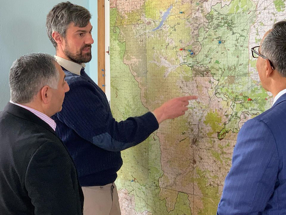 The HALO Trust's Artsakh Program Manager Rob Syfret offers the ANCA National Board Members Raffi Hamparian and Steve Mesrobian the latest update on their Artsakh demining efforts during a February, 2020, working visit to Artsakh for an international ANCs summit.